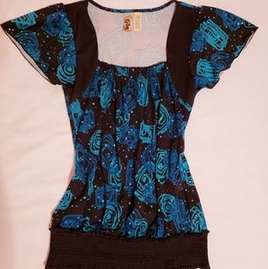 Blue and black blouse with roses.